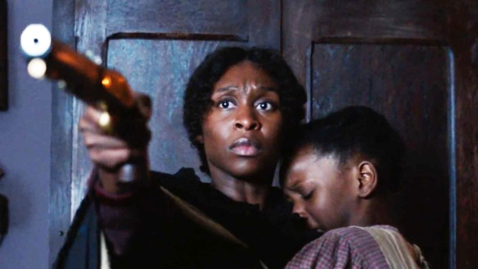 Harriet-Cynthia-Erivo-with-gun-and-child, Harriet as Igbo, Culture Currents