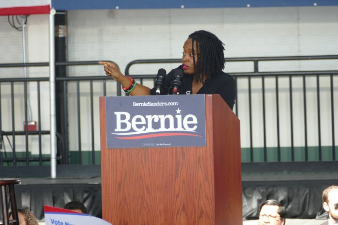 Carol-Fife-of-ACCE-speaks-at-Bernie-rally-by-Jahahara, All aboard … for Reparations!, Local News & Views