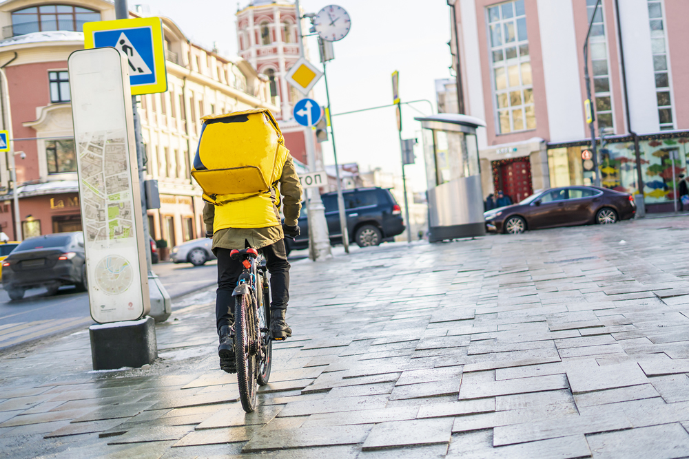Person on a bicycle making a delivery