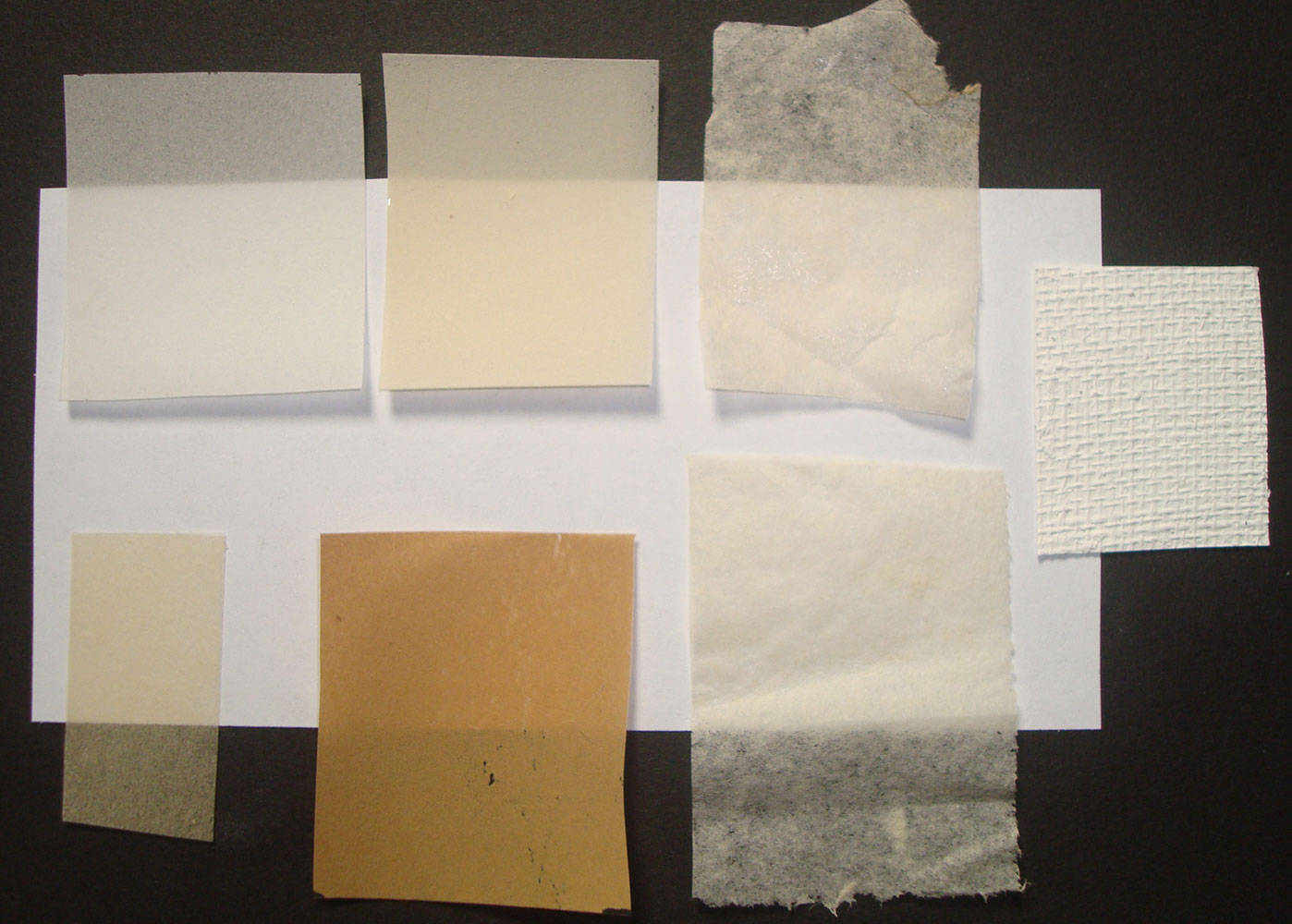 Samples of hand made papers with Solkafloc (the four to the left), with whatman fibers (to the right, and a sample of a texturized filling material with the addition of paper as a filler.