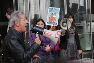 California Assemblyman Tom Ammiano lambastes Gov. Jerry Brown's veto of the Trust Act to a group of about 200 protesters outside the San Francisco State Building on Thursday Oct. 4, 2012. (Alex Emslie)