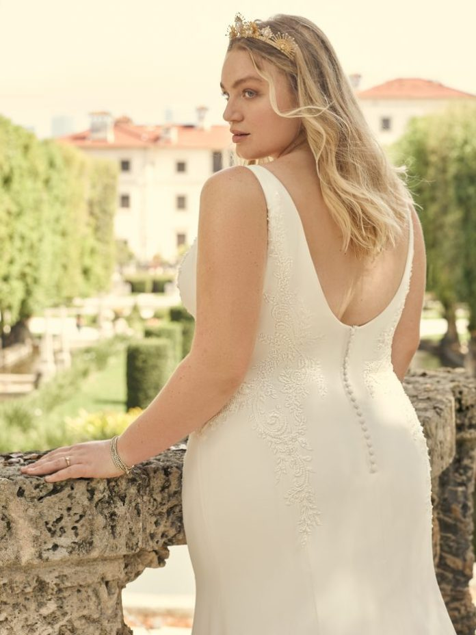 Bride Wearing Crepe Sheath Plus Size Wedding Dress Called Adrianna by Maggie Sottero