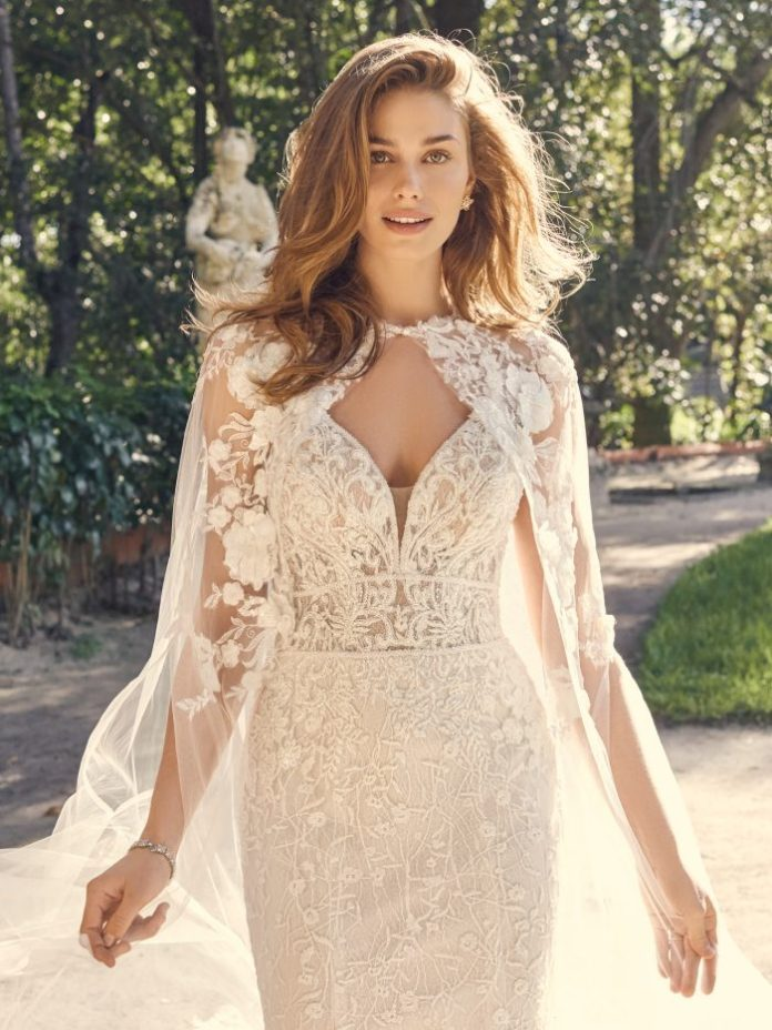 Bride wears long train wedding dress named Gretna by Maggie Sottero