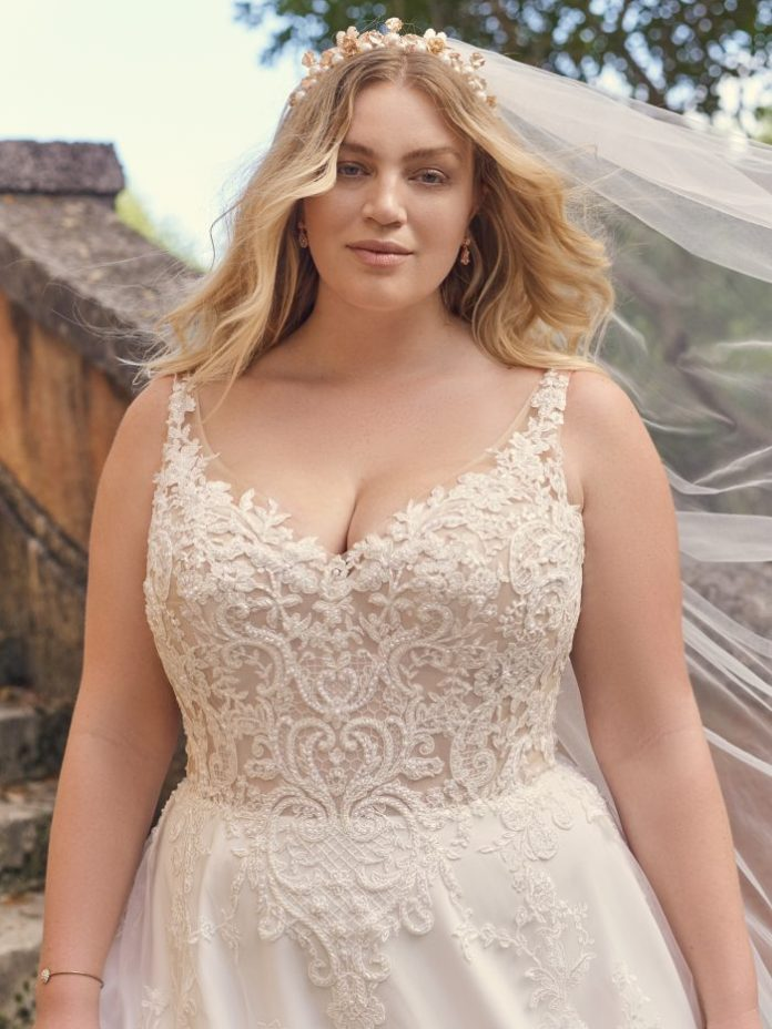 Bride Wearing Plus Size Ball Gown Wedding Dress Called Tiffany by Maggie Sottero
