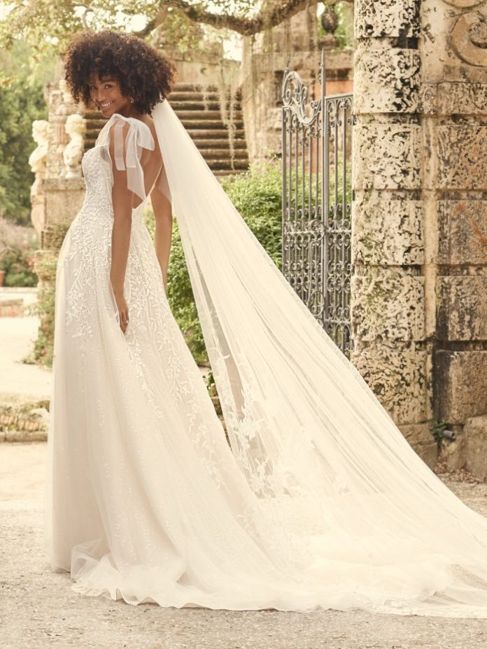 Bride Wearing Whimsical A-line Wedding Dress for Tall Body Types Called Waverly by Maggie Sottero