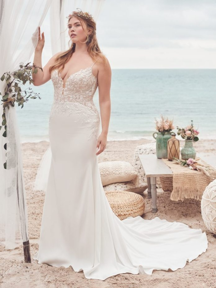 Bride wears affordable crepe sheath wedding dress called Alda by Rebecca Ingram