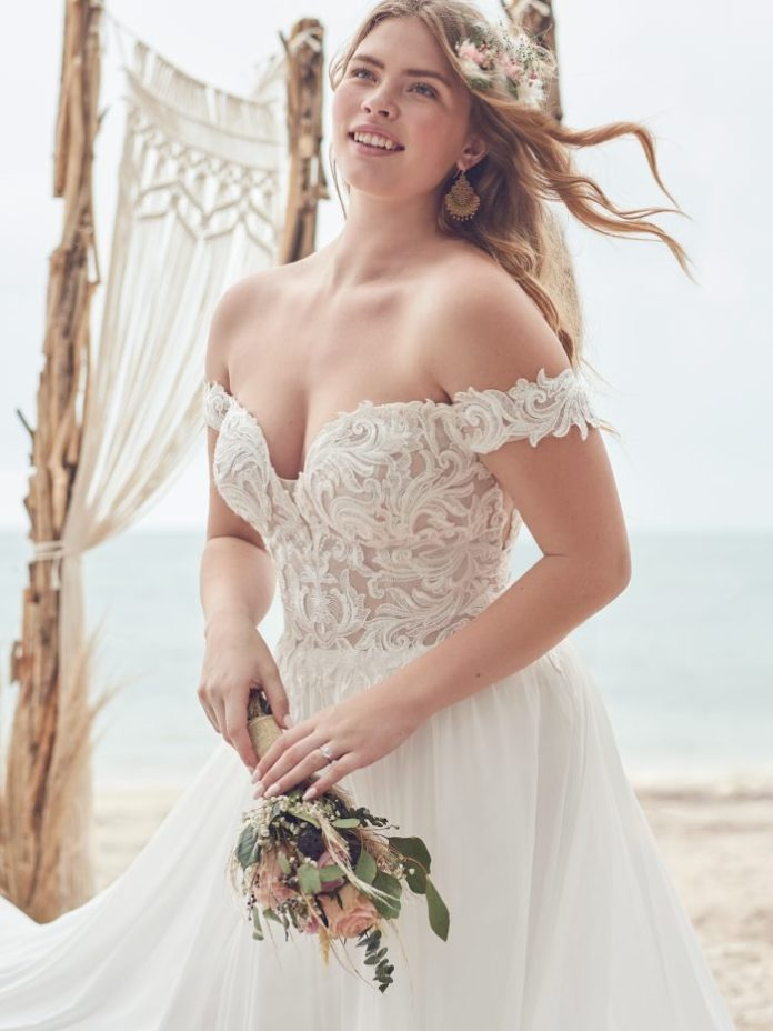 Bride Wearing Off-the-Shoulder A-line Wedding Dress for Petite Body Shapes Called Heather by Rebecca Ingram