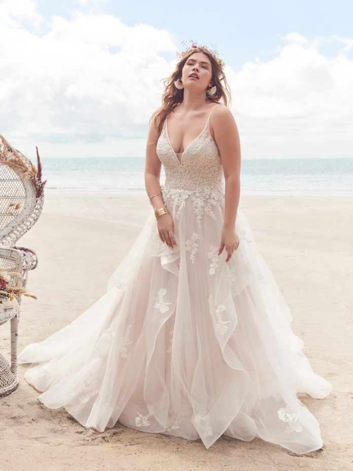 Bride Wearing Ruffled Ball Gown Wedding Dress for Pear-Shaped Body Types Called Lettie by Rebecca Ingram