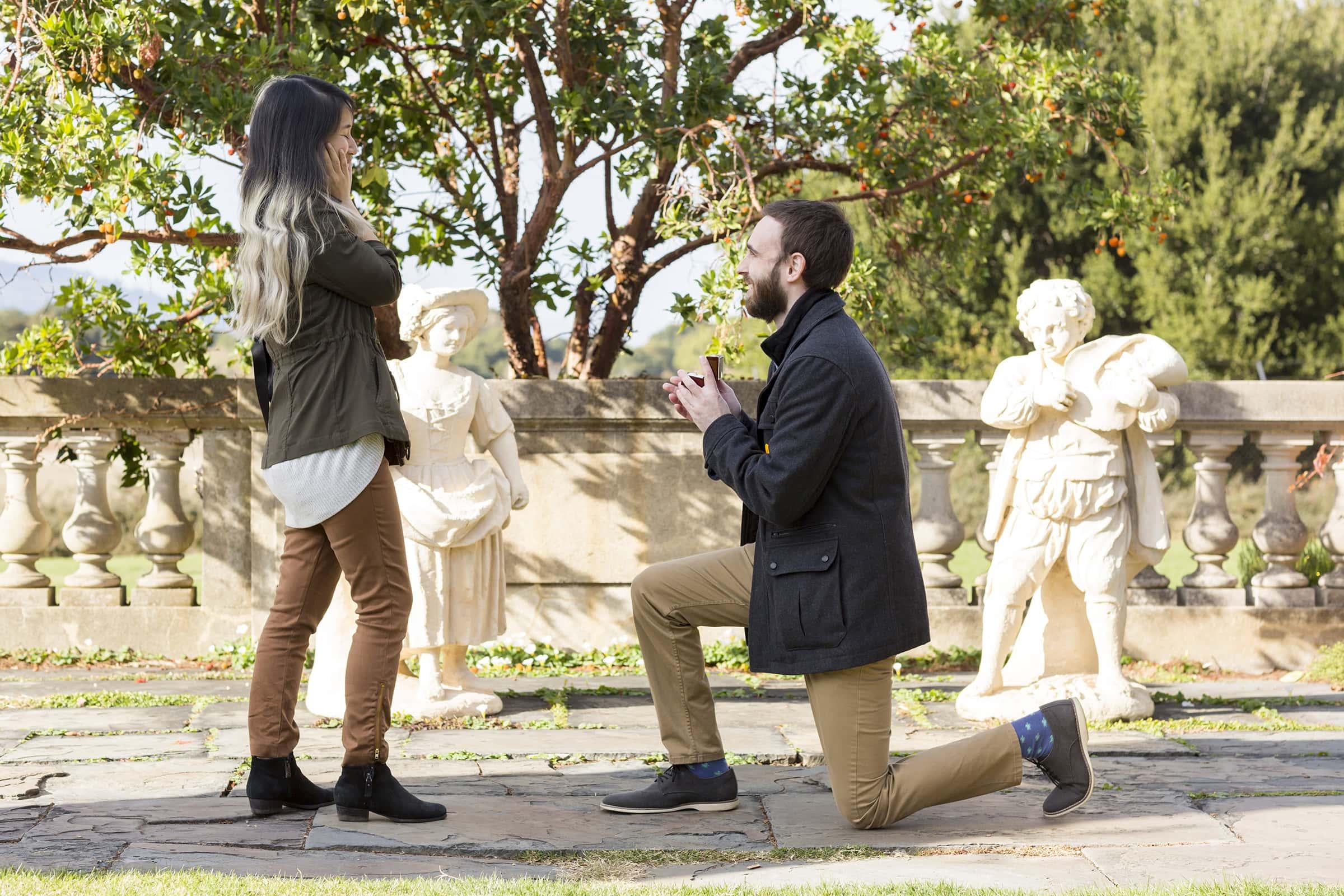 filoli marriage proposal guy in green jacket on his knee proposing to girl in green jacket