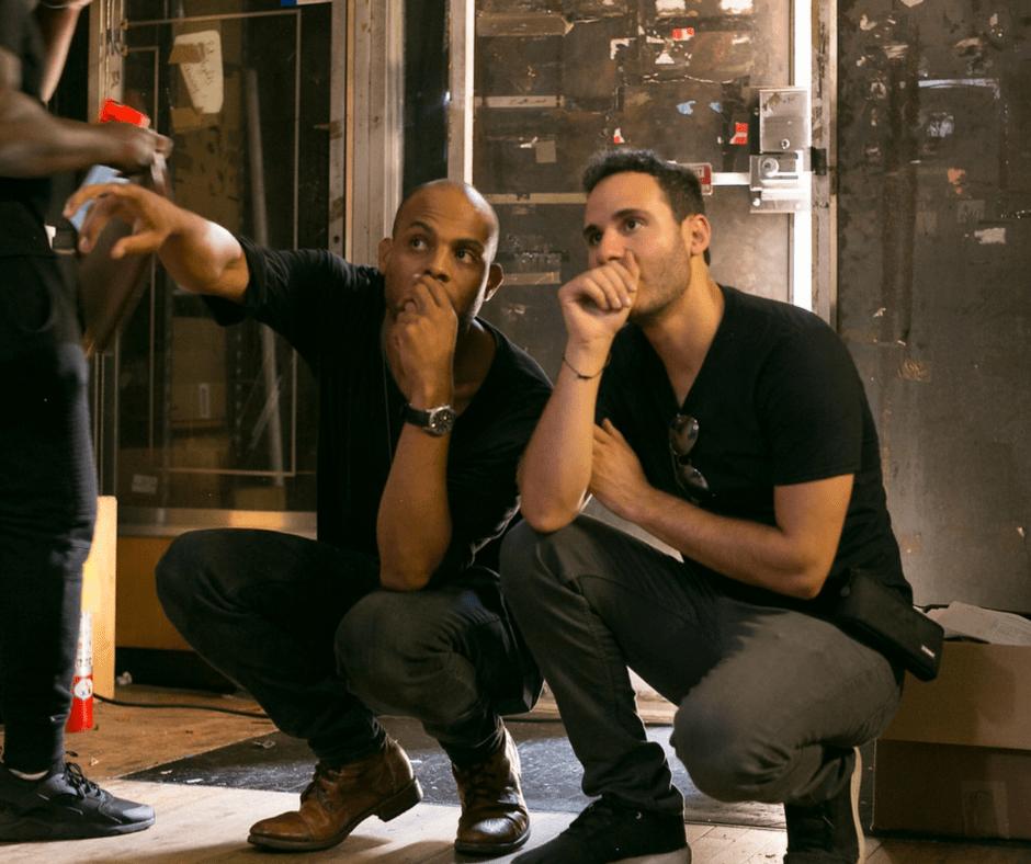Two crew members on set