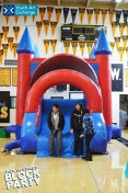 Some of YAX's Youth Advisory Board members testing out the bounce house