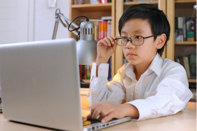 childhood myopia, child, boy, computer, laptop, glasses, spectacles, vision, sight, work