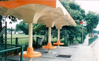 The orange top old bus stop that is rarely seen today