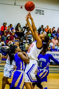 Brishuana Barnes shoots in the first half of the contest against Americus-Smuter. Photo: Erin Parker/SGSN