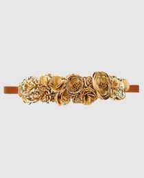 Cinturón de cinta con flores dorado