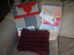 We received 1 quilt, 1 burgundy prayer shawl, and 1 fleece lapghan donated by Mae Totz in memory of her husband, Ray.