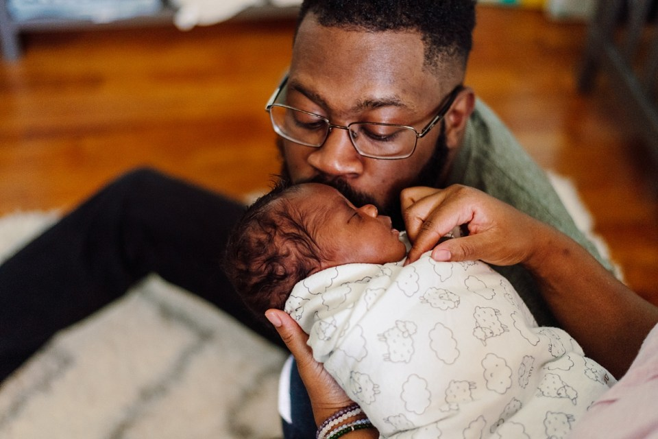 lifestyle newborn photography black dad philadelphia