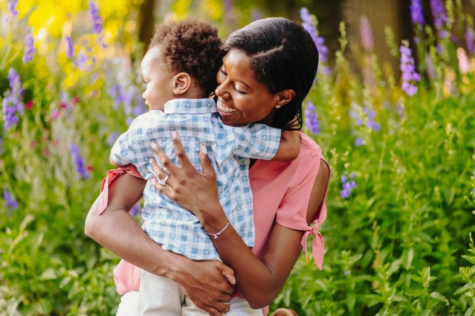 mother son hugs in bartram's garden