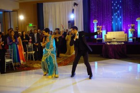 Check out the bride and groom dancing on the slick white dance floor.