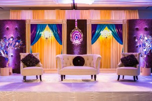 Sweetheart table for an Indian wedding reception with turquoise and purple designs