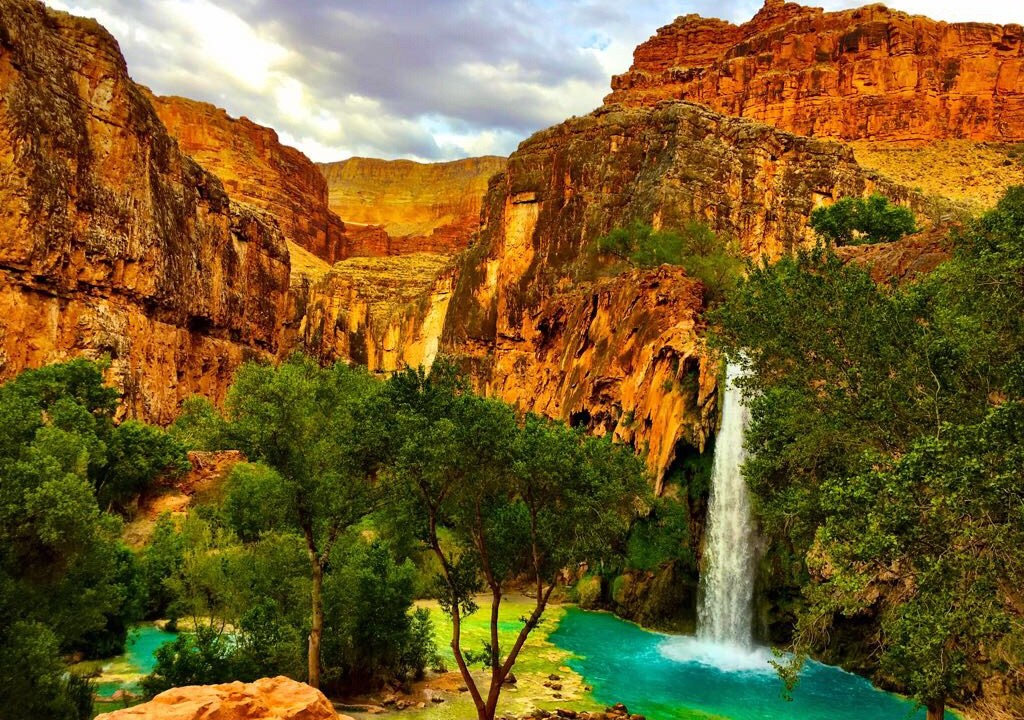 Camping at Havasu Falls is an unforgettable experience. It is located on  protected tribal land of the Havasupai Tribe and borders the Grand Canyon.