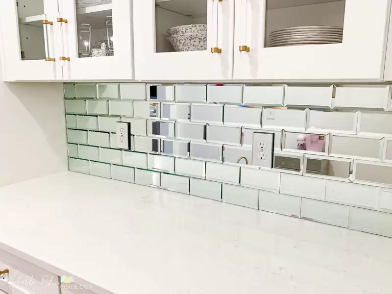 install a mirrored tile backsplash