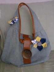 Handbag with fabric scrap brooches