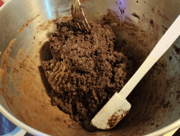 Tablea chocolate mixture being finished off by hand mixing