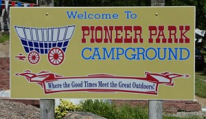 Sign: Pioneer Park RV Campground. Where good times meet the great outdoors.