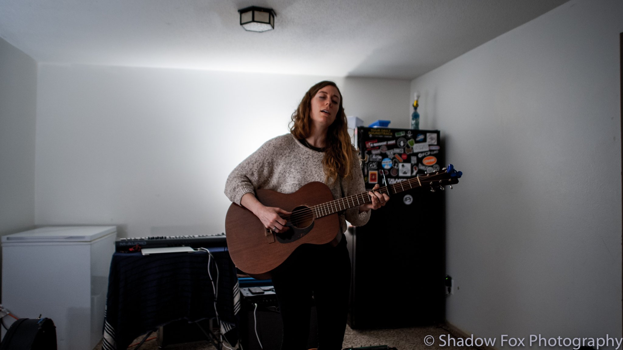 Laura McElroy playing the first show we booked at our new house