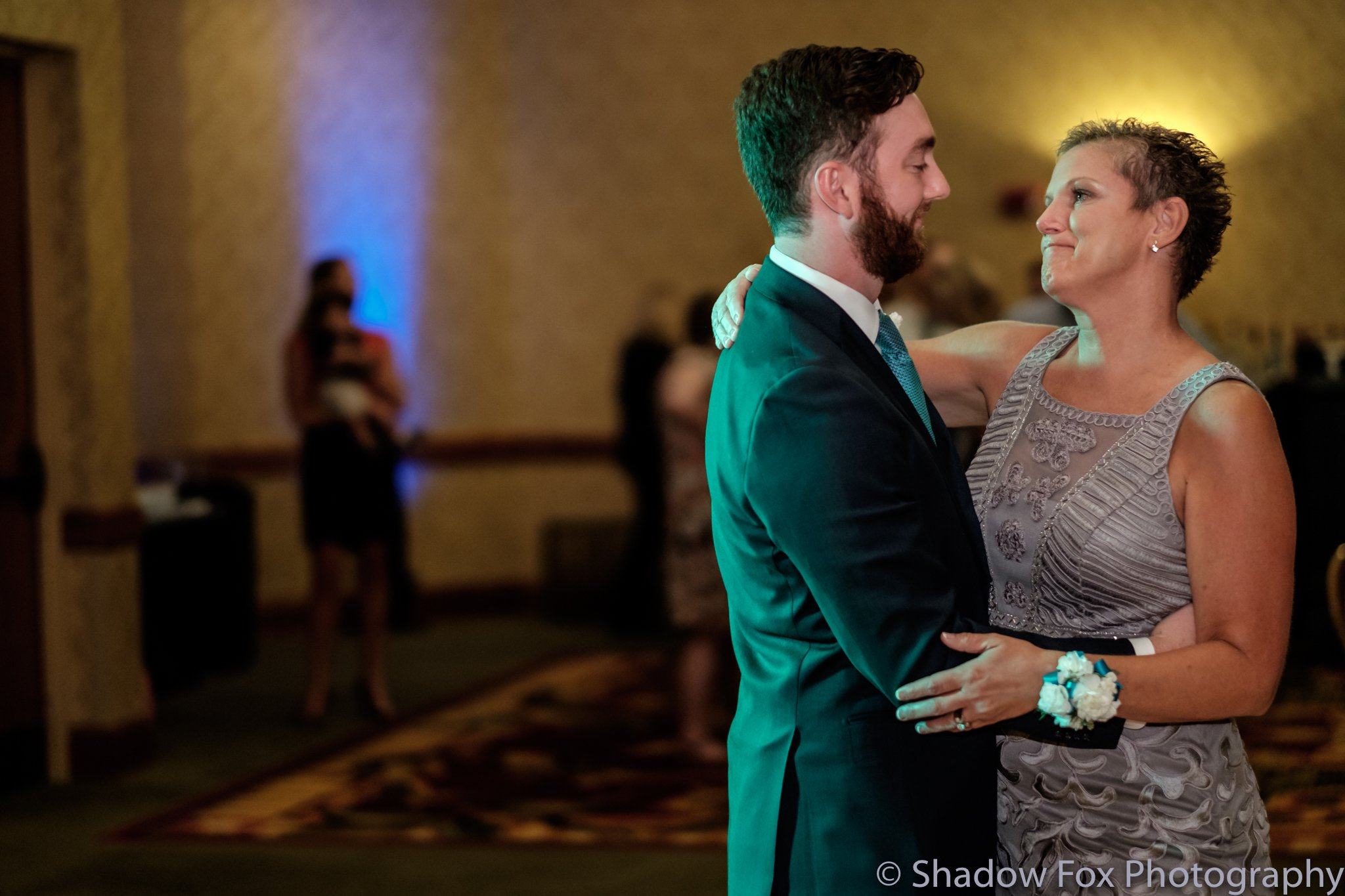 Groom and mom share a dance at the wedding reception