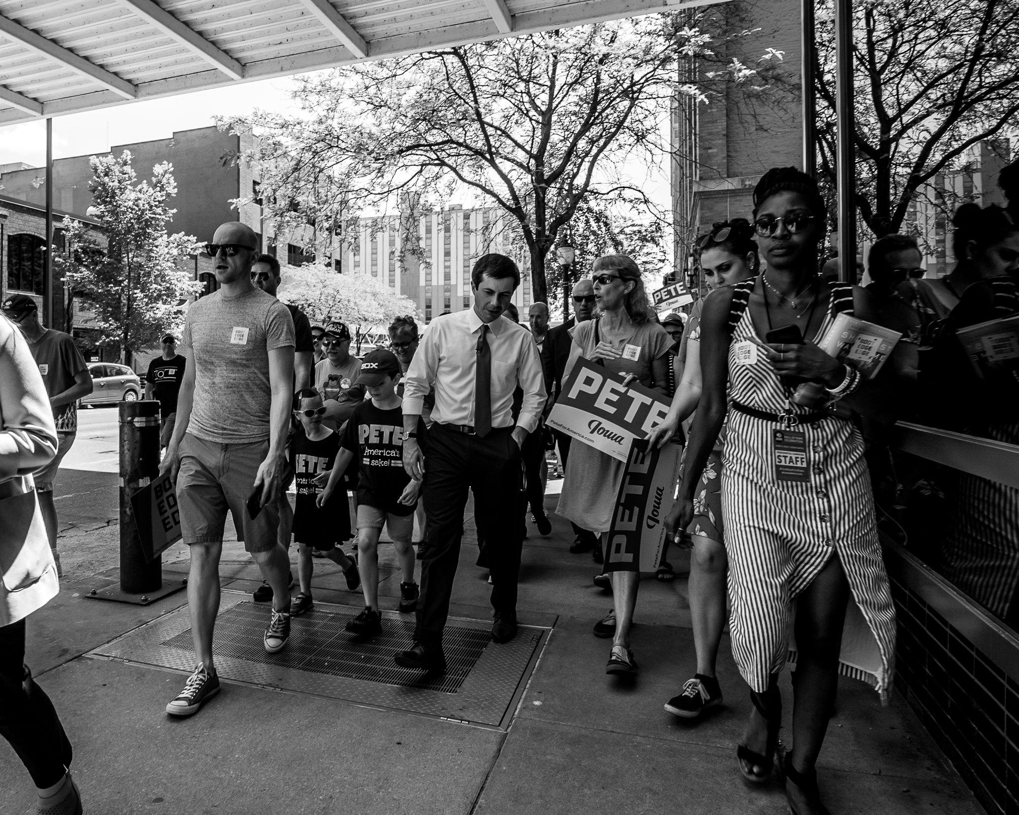 Pete Buttigieg leading supporters through downtown Cedar Rapids, Iowa
