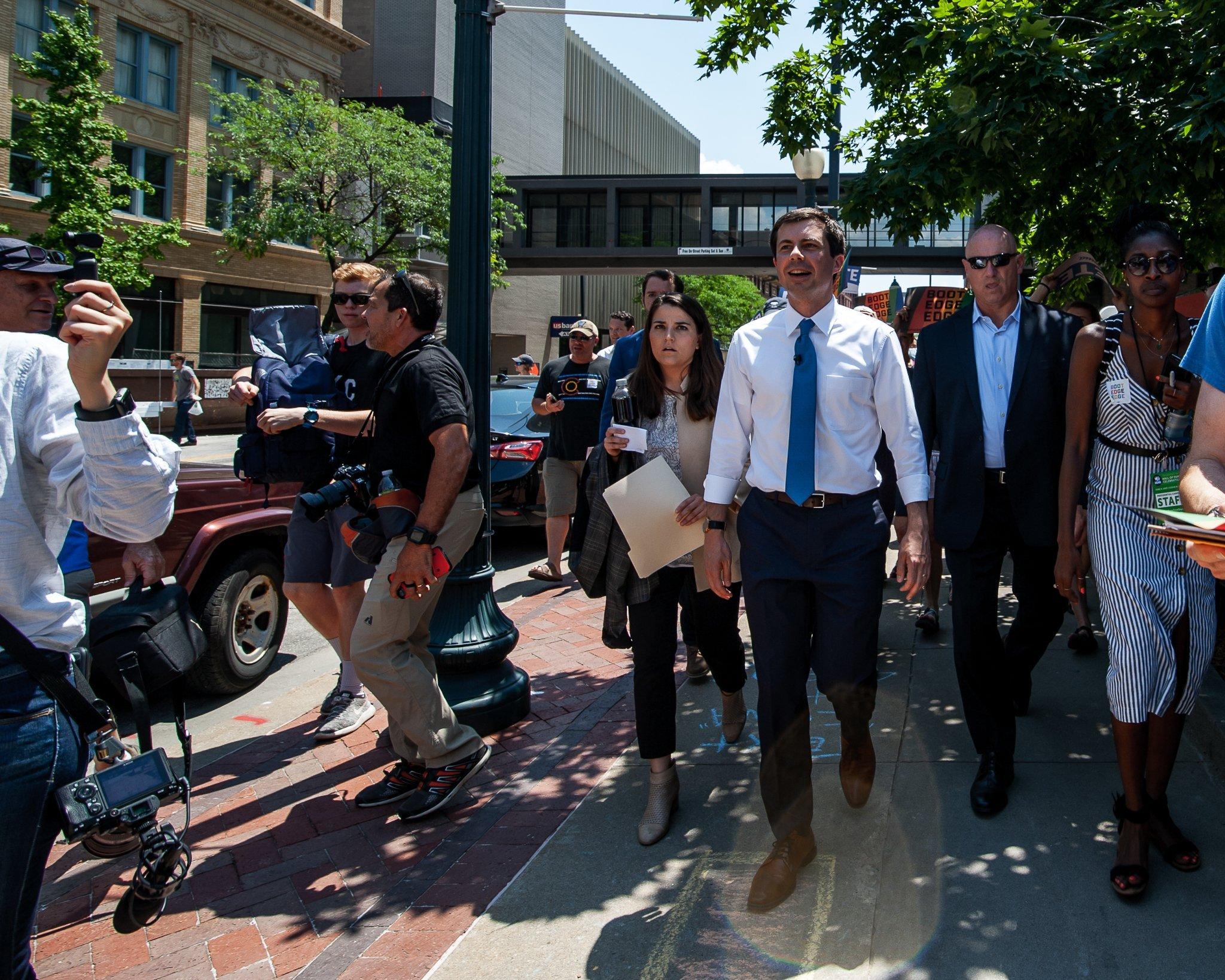 Pete Buttigieg walking through downtown Cedar Rapids, Iowa with supporters