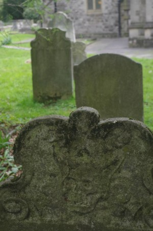 View of tombstones with horned skull in foreground. ©Carole Tyrrell