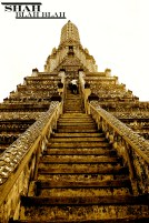 Climbing the intense staircase of the vertical Wat Arun