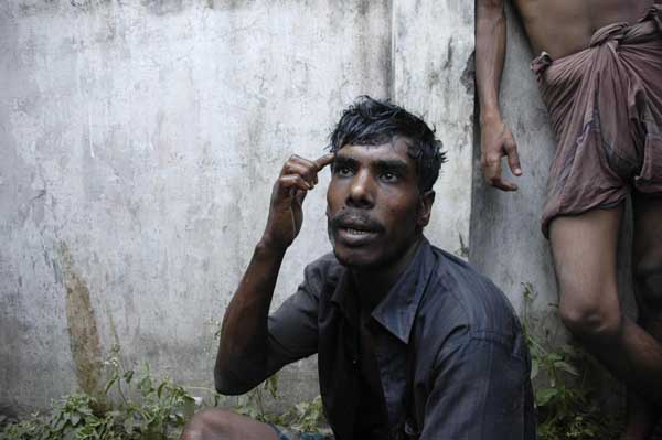 Many innocent civilians got caught up in the fight. Bus helper Muhammad Babu talks of his near escape. One of his compatriots died while two others were hit by bullets. 25th February 2009. Dhanmondi. Noor Alam/DrikNews