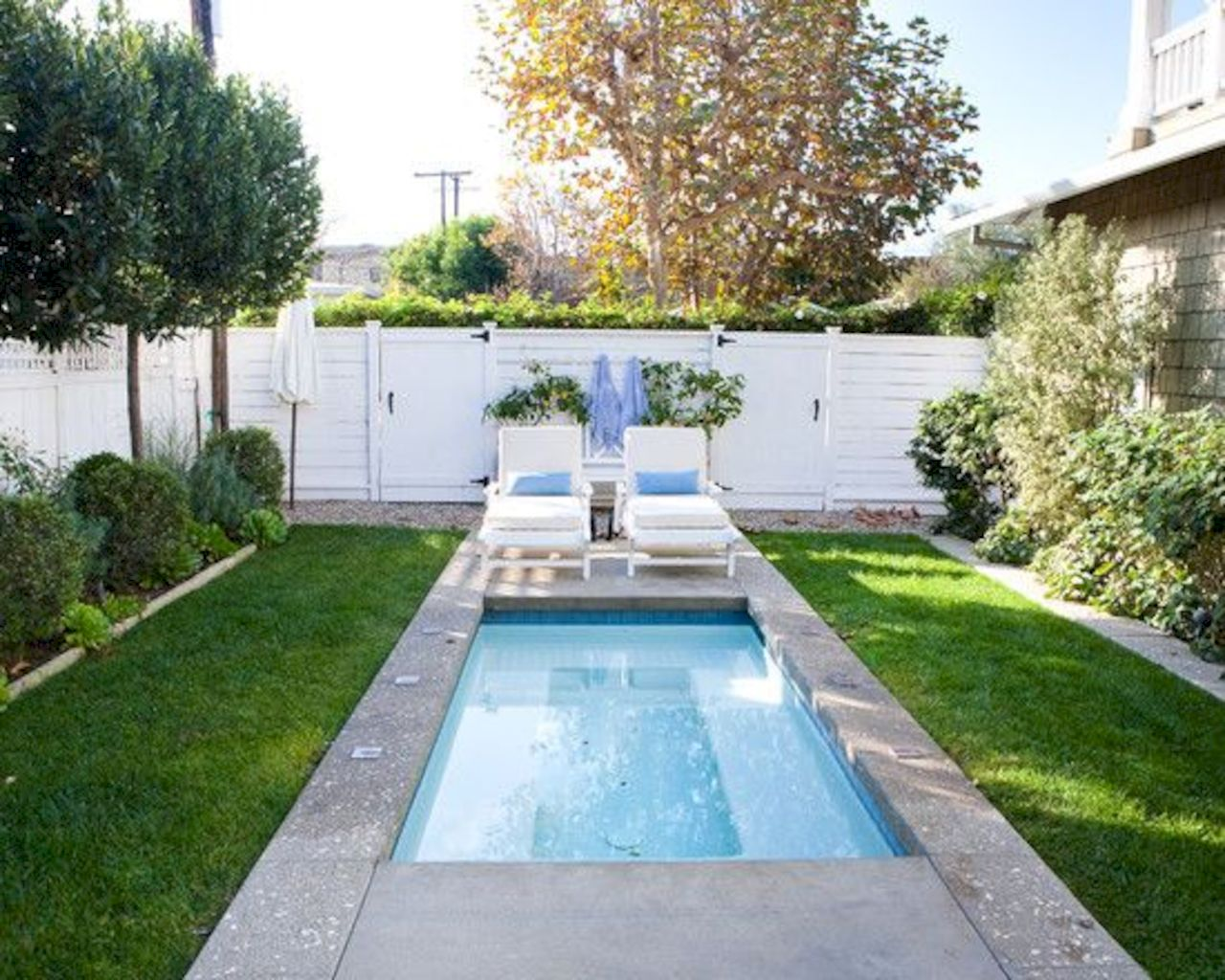 Affordable rectangular pool designs built in small areas that give a lavish look getting along with beautiful landscape (38)