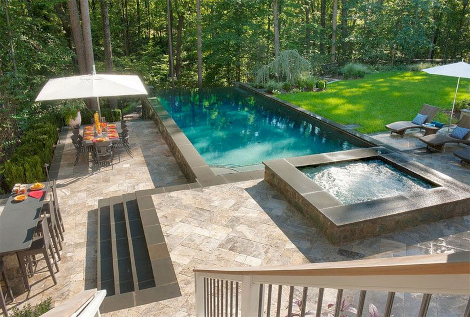 Affordable rectangular pool designs with stone sidings that give a lavish look perfect for summer outdoor parties (1)