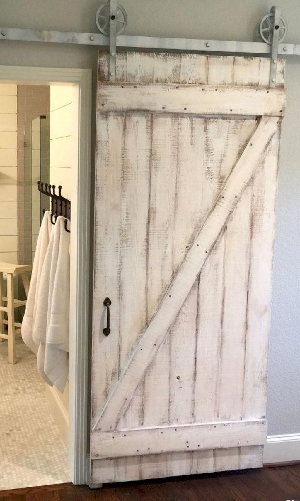 Barn style sliding doors applied as bedroom doors showing a rustic accent in the modern country homes Image 1
