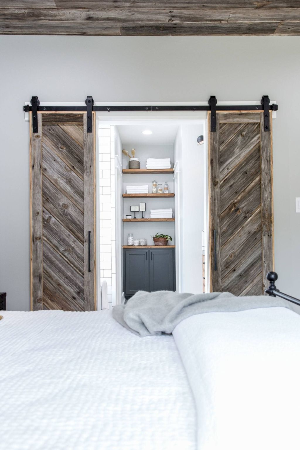 Barn style sliding doors applied as bedroom doors showing a rustic accent in the modern country homes Image 11