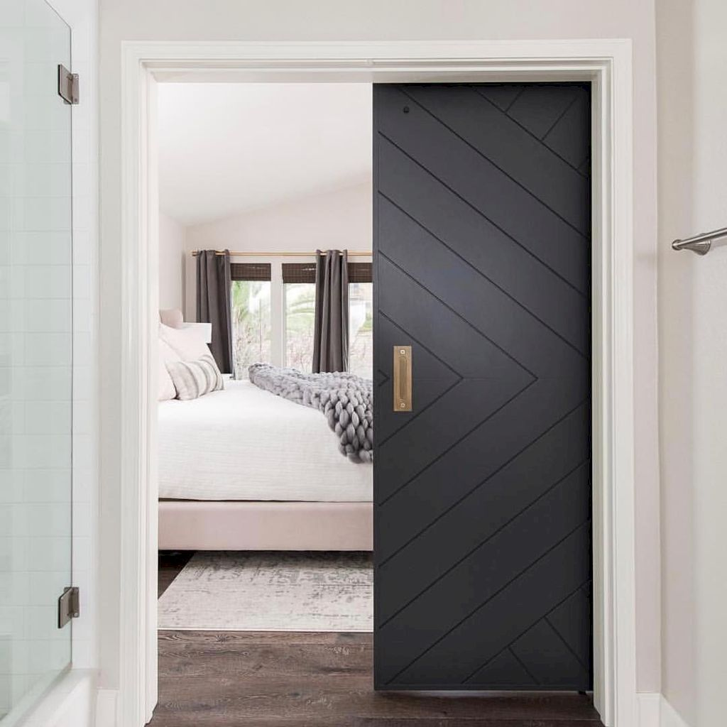 Barn style sliding doors applied as bedroom doors showing a rustic accent in the modern country homes Image 18
