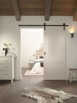 Barn style sliding doors applied as bedroom doors showing a rustic accent in the modern country homes Image 21