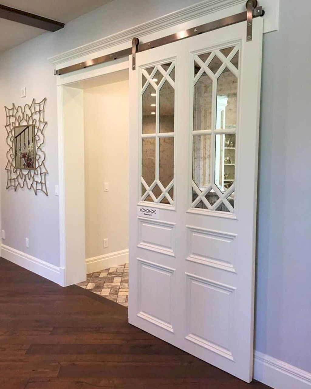 Barn style sliding doors applied as bedroom doors showing a rustic accent in the modern country homes Image 25