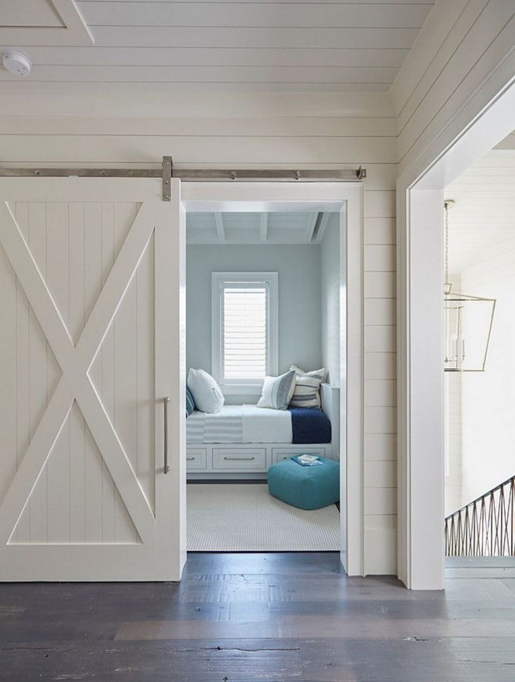 Barn style sliding doors applied as bedroom doors showing a rustic accent in the modern country homes Image 26