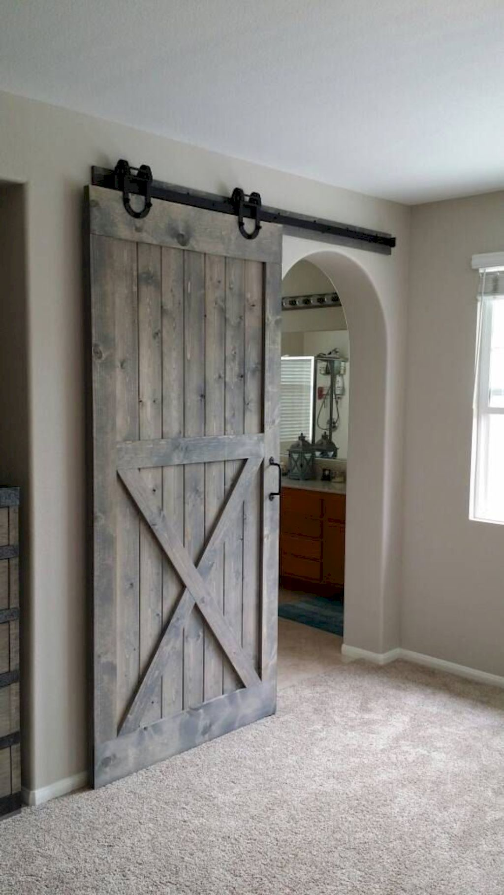 Barn style sliding doors applied as bedroom doors showing a rustic accent in the modern country homes Image 27