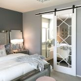 Barn style sliding doors applied as bedroom doors showing a rustic accent in the modern country homes Image 34
