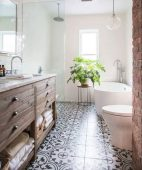 Beautiful bathroom update with eclectic patterned tiles and ethnic rugs very efficient to improve bathroom floor design Image 3