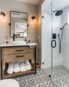 Beautiful bathroom update with eclectic patterned tiles and ethnic rugs very efficient to improve bathroom floor design Image 34