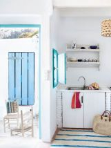 Chic decoration with lots of nautical accents giving a refreshing coastal cottage feel to modern kitchens Image 19