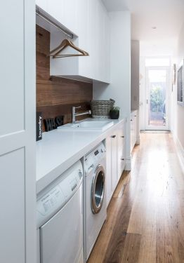 Classy laundry room update with first class finishing to make a functional room that looks elegant and stylish Image 12